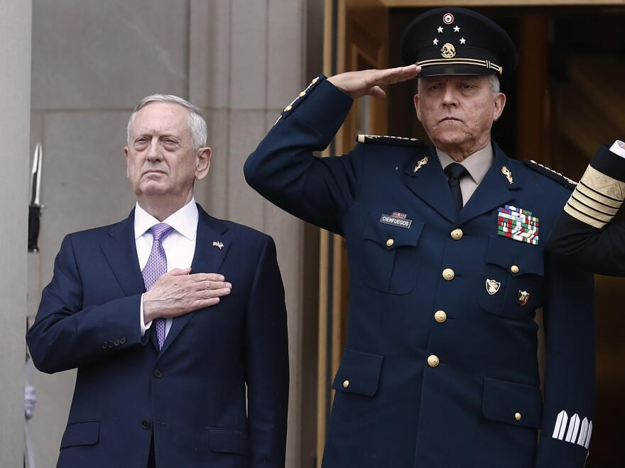 Former Mexican Defense Secretary Gen. Salvador Cienfuegos, right, with former U.S. Defense Secretary Jim Mattis at the Pentagon in 2017. Cienfuegos was arrested on a DEA warrant at Los Angeles International Airport Thursday.