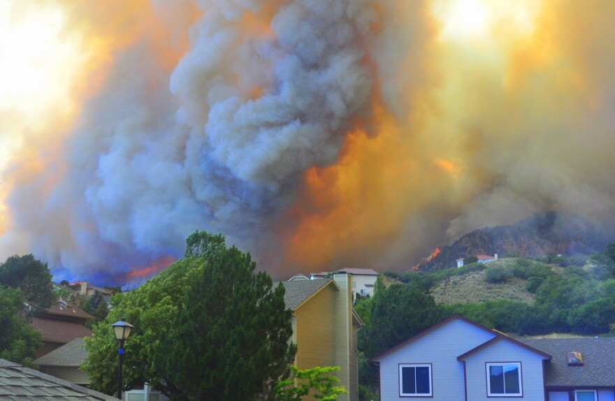 The fire was already burning in their Waldo Canyon neighborhood when Janet Wilson and her partner Stephen Gandy finished packing their cars and joined the evacuation.