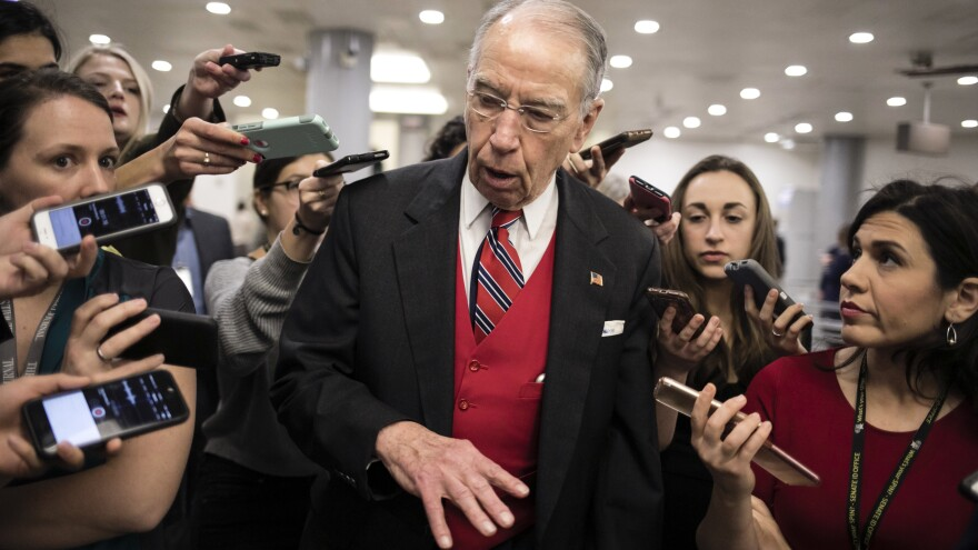 Senate Judiciary Committee Chairman Chuck Grassley, R-Iowa, speaks with reporters after a vote. Journalists' normal access is being constrained for the impeachment trial.