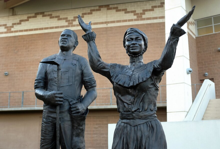 Statues from the Juneteenth memorial at the George Washington Carver Museum.