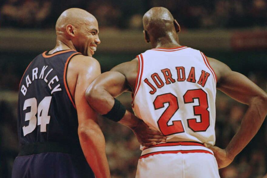 Charles Barkley, left, laughs with Chicago Bulls guard Michael Jordan during a game in Chicago in January 1996.