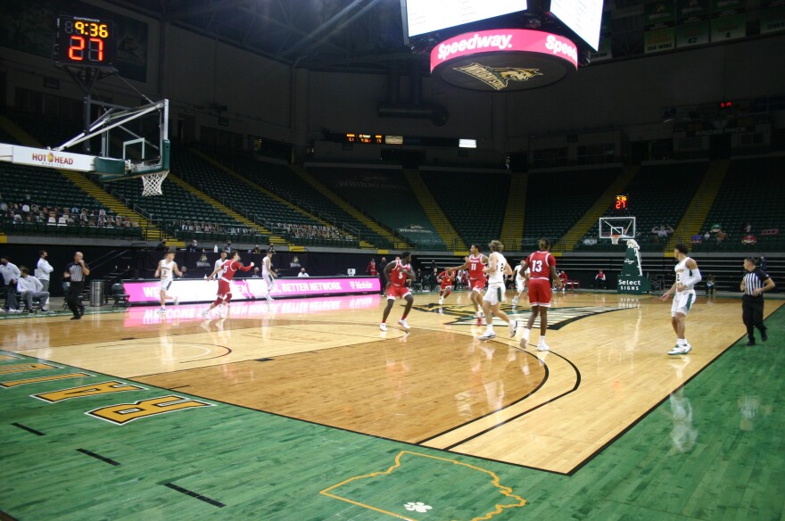 Miami Redshirt Junior Guard Isaiah Coleman-Lands crosses half court in the second half of the Redhawks game against Wright State. Cardboard cutouts watch from the first few rows.