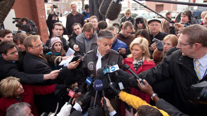 """Former Utah Gov. Jon Huntsman speaks to reporters before a campaign stop in Concord, N.H. In interviews, Huntsman has said that his goal in New Hampshire is to """"beat market expectations."""""""