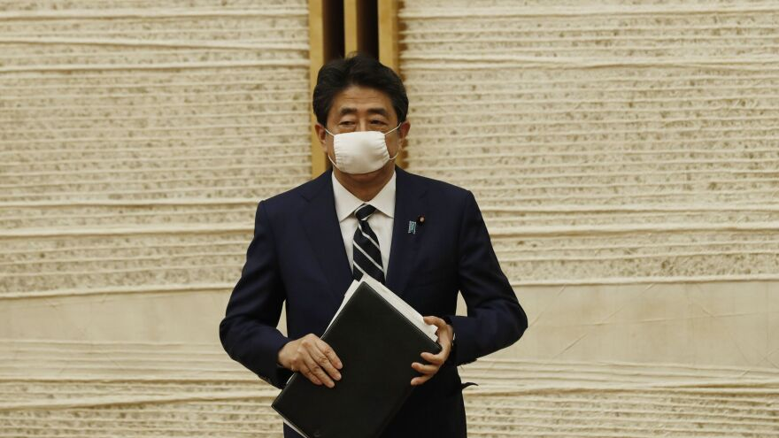 Japanese Prime Minister Shinzo Abe leaves a news conference Monday in Tokyo, after lifting the country's nationwide state of emergency over the coronavirus.
