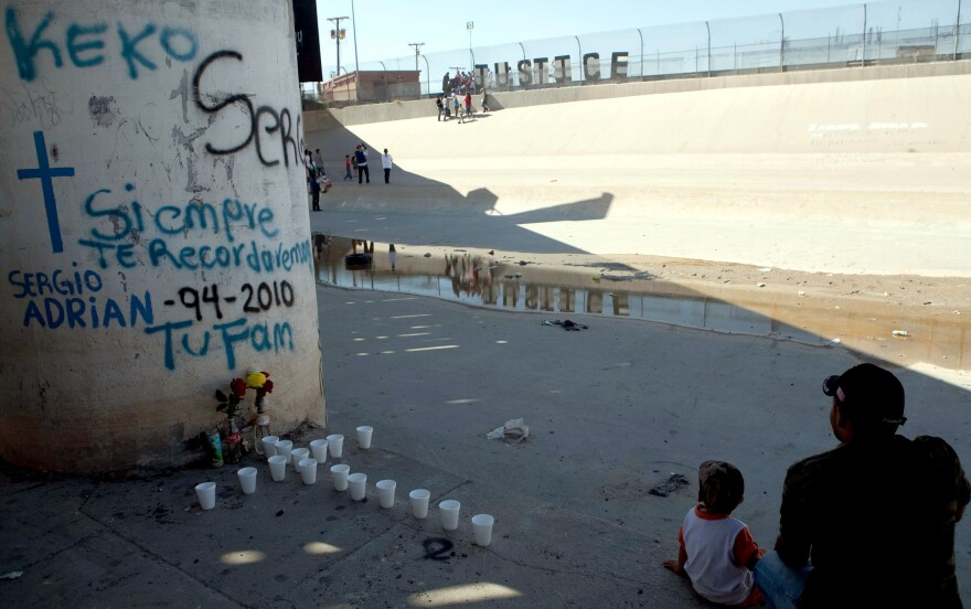 Relatives of Sergio Hernández sit in Ciudad Juarez at the U.S.-Mexico border, on the second anniversary of his killing in 2012.