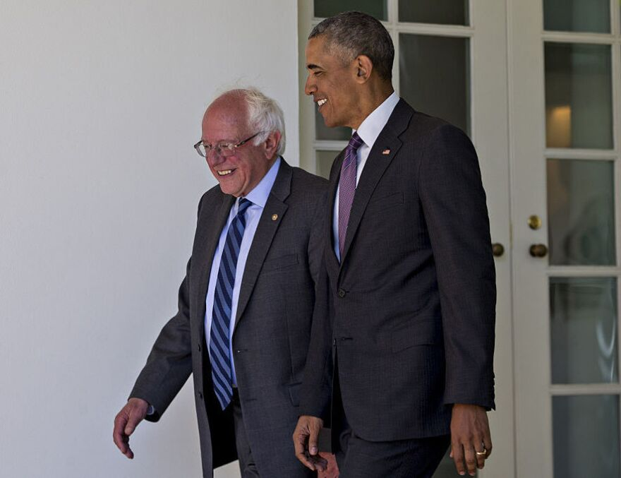 President Obama and Sen. Bernie Sanders walk to the Oval Office of the White House on Thursday.