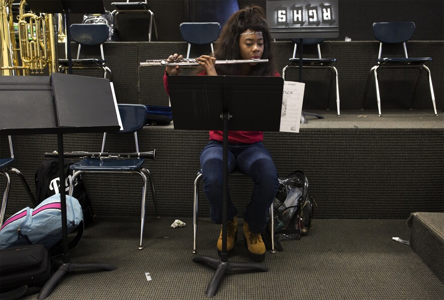 Ngone Seck, 17, plays flute with the Riverview Gardens High band.