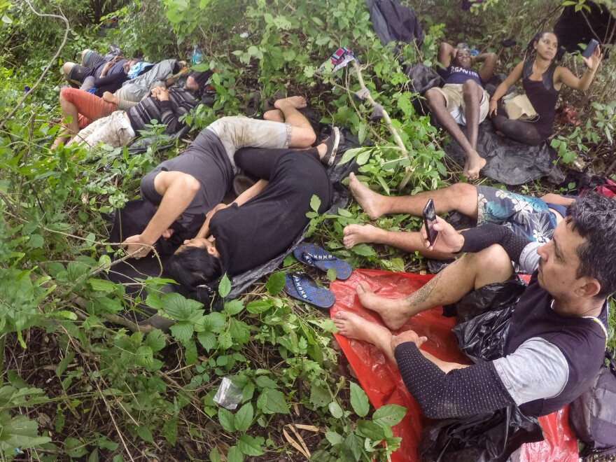 Migrants sleep on the ground in the Nicaraguan backcountry, waiting to continue their journey.