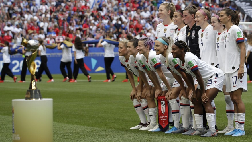 Players line up for a photo prior to the Women's World Cup final between the U.S. and the Netherlands in Décines, outside Lyon, France, on July 7, 2019. The U.S. team won 2-0 for its fourth World Cup title.