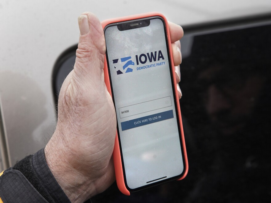 Precinct captain Carl Voss of Des Moines displays the Iowa Democratic Party caucus reporting app on his phone outside the Iowa Democratic Party headquarters on Tuesday.