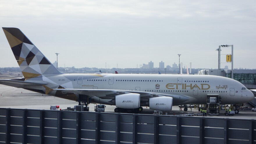 An Etihad Airways jet is parked at JFK International Airport in New York on Tuesday. Passengers traveling to the United States from 10 airports in eight Muslim-majority countries will have to check most electronics. The ban will affect flights on Royal Jordanian, EgyptAir, Turkish Airlines, Saudi Arabian Airlines, Kuwait Airways, Royal Air Maroc, Qatar Airways, Emirates and Etihad Airways.