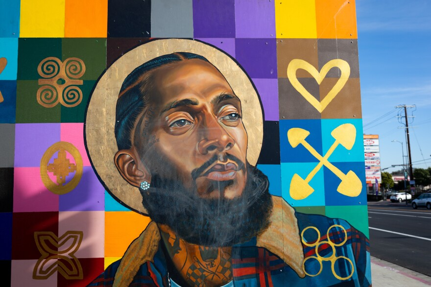 Nipsey Hussle is part of a mural featuring other local notable people on the wall of a bank in the rapper's Hyde Park neighborhood. In the wake of Hussle's March 2019 death, many murals of the beloved Los Angeles musician were painted in the Hyde Park neighborhood near his Marathon Clothing store.