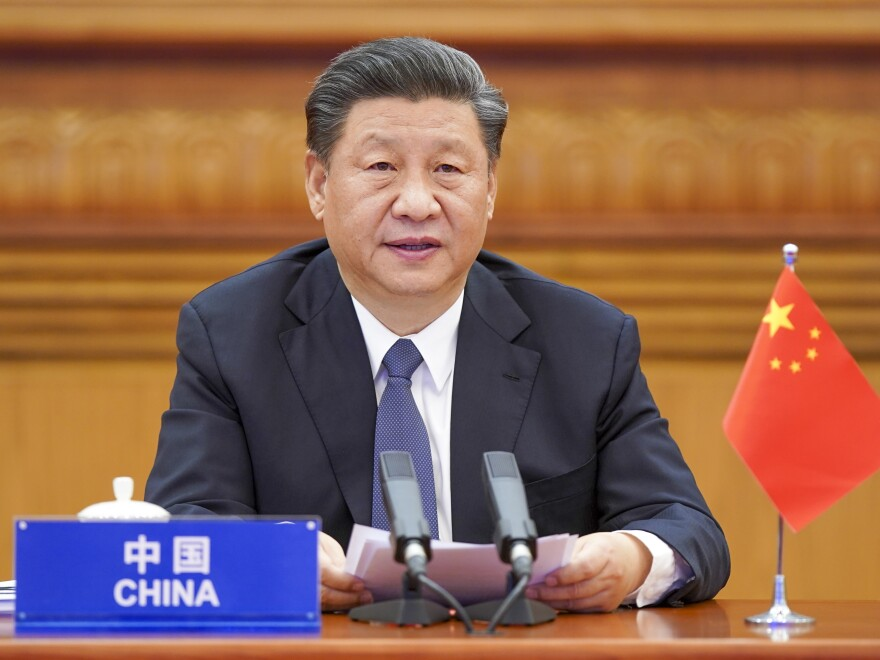 In this photo released by Xinhua News Agency, Chinese President Xi Jinping attends the G-20 Extraordinary Virtual Leaders' Summit on COVID-19 via video link in Beijing.