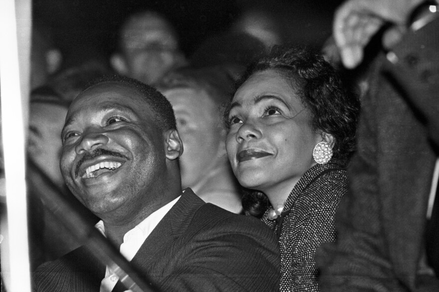 Martin Luther King Jr. and his wife Coretta watch a performance by Sammy Davis Junior on the eve of the march into Montgomery.