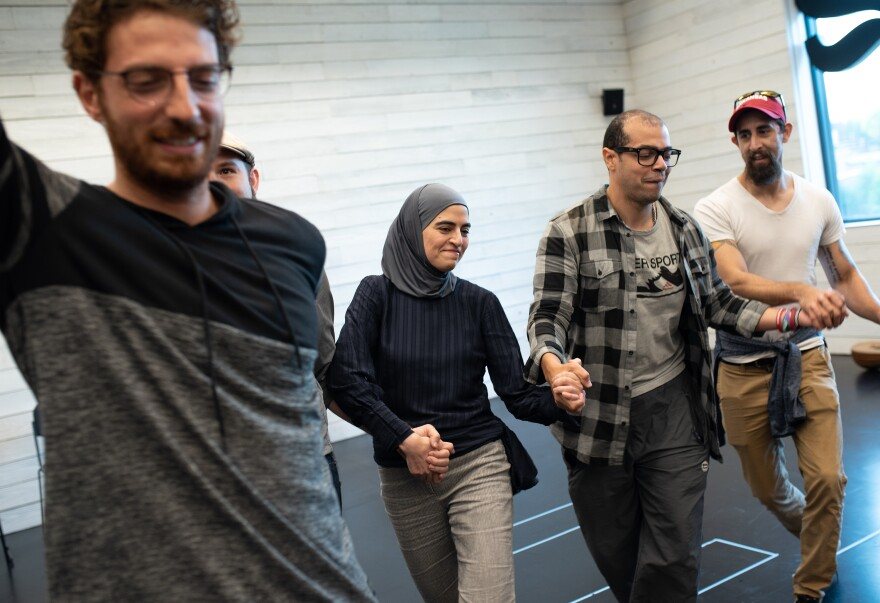 Kholoud Sawaf (second from left) participates in a community workshop discussing cultural elements of her play.
