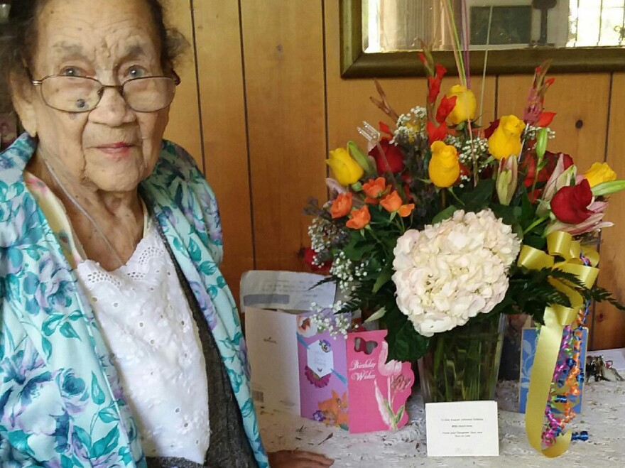 Ella Augusta Johnson Dinkins, posing on her 102nd birthday, at her home in Eatonville, Fla.