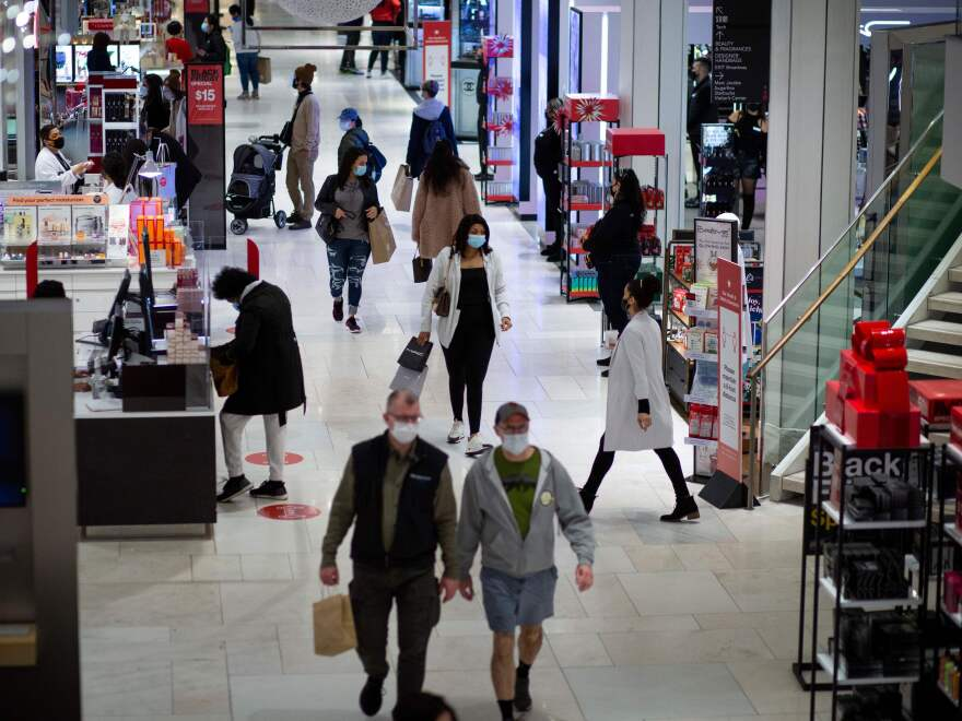 Shoppers walk through Macy's in New York on Black Friday, Nov. 27.