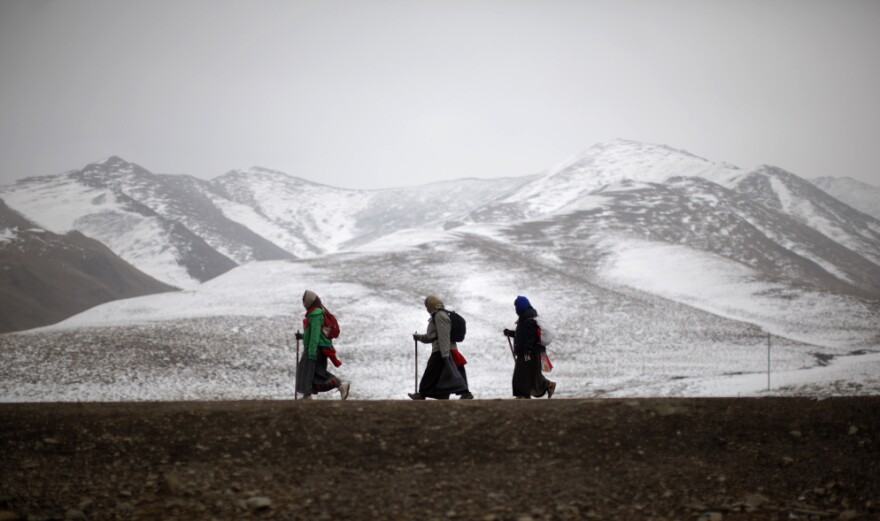 Ethnic Tibetan pilgrims walk on a road during Tibetan New Year in Langmusixiang, Sichuan province, in western China, Feb. 22. Celebrations are subdued in the Tibetan areas of China this year, after a string of self-immolations and protest against Chinese control.