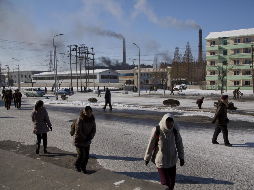North Koreans walk along a snowy street in Pyongyang, North Korea, on Dec. 13, 2013. Many North Koreans are angry that coal — used to to heat their homes — became more expensive as coal exports to China increased.
