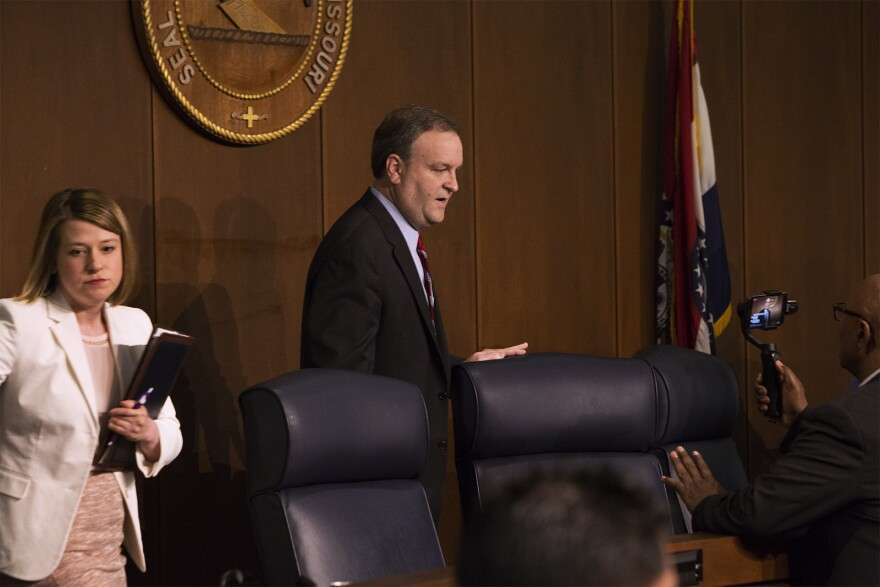 St. Louis County council member Sam Page leaves the dais after being voted in as the new county executive Monday night.