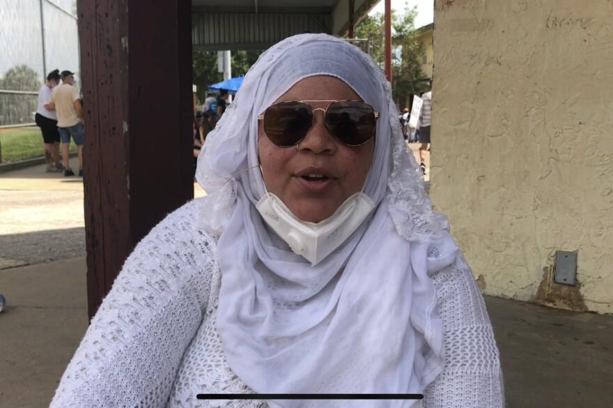 A headshot of a woman wearing a white hijab.