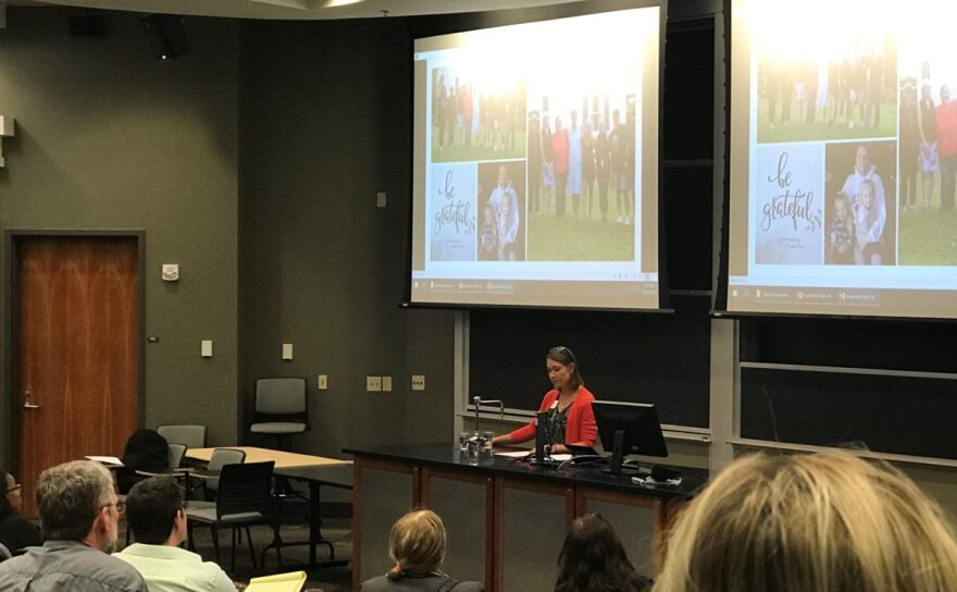 Betsy Anderson highlights the importance of recovery housing at a symposium for solutions in Athens, Ohio.