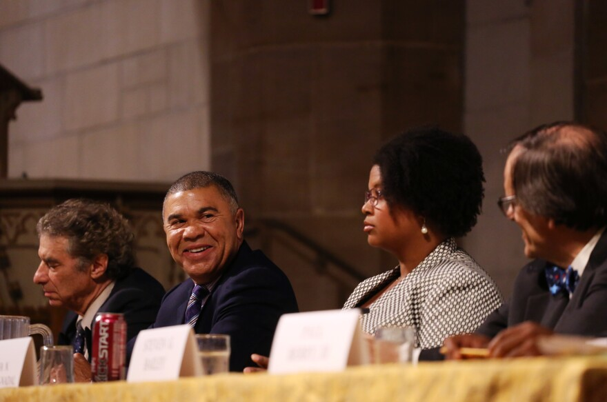 U.S. Rep. William Lacy Clay, D-University City, looks toward the other candidates at Tuesday night's forum.