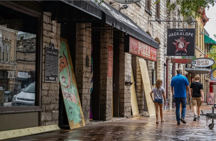 Workers boarded up bars on West 6th Street in Austin after Gov. Greg Abbott ordered them closed for the second time in three months on June 26.