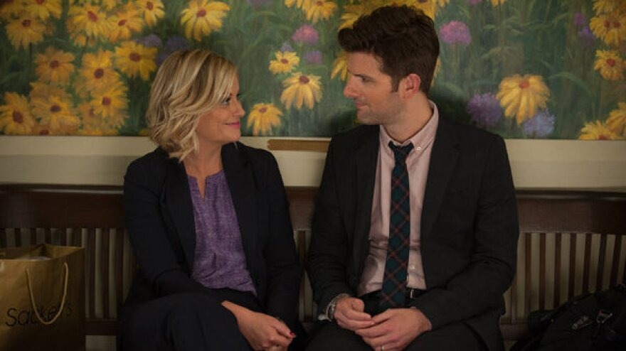 Amy Poehler as Leslie Knope and Adam Scott as Ben Wyatt on NBC's deeply pro-nerd <em>Parks And Recreation</em>.