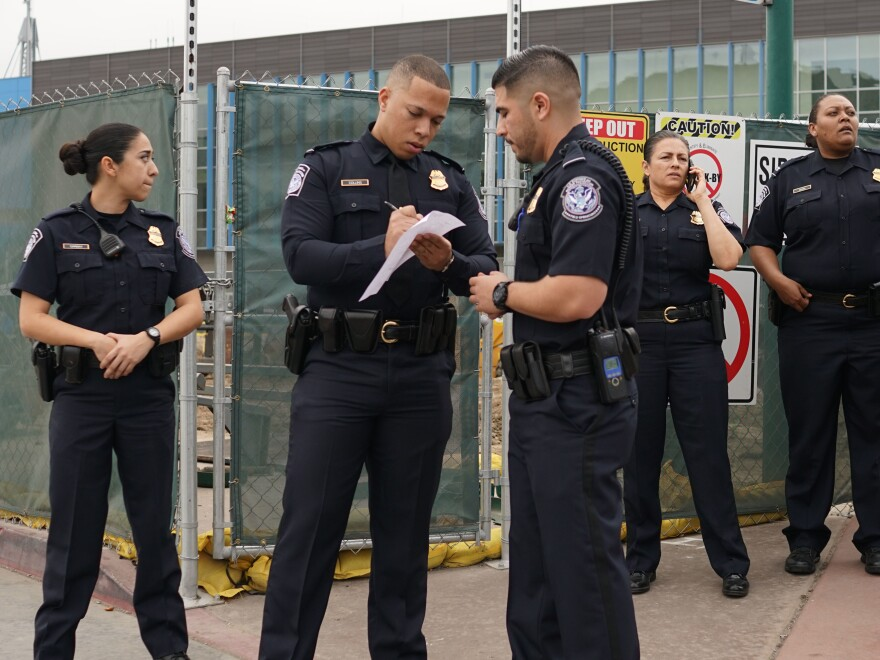 Customs and Border Protection agents stand at the San Ysidro Port of Entry on Friday, Feb. 10. One memorandum issued by the Department of Homeland Security says the government will hire new ICE officers and Border Patrol agents, but it doesn't mention hiring more immigration judges.