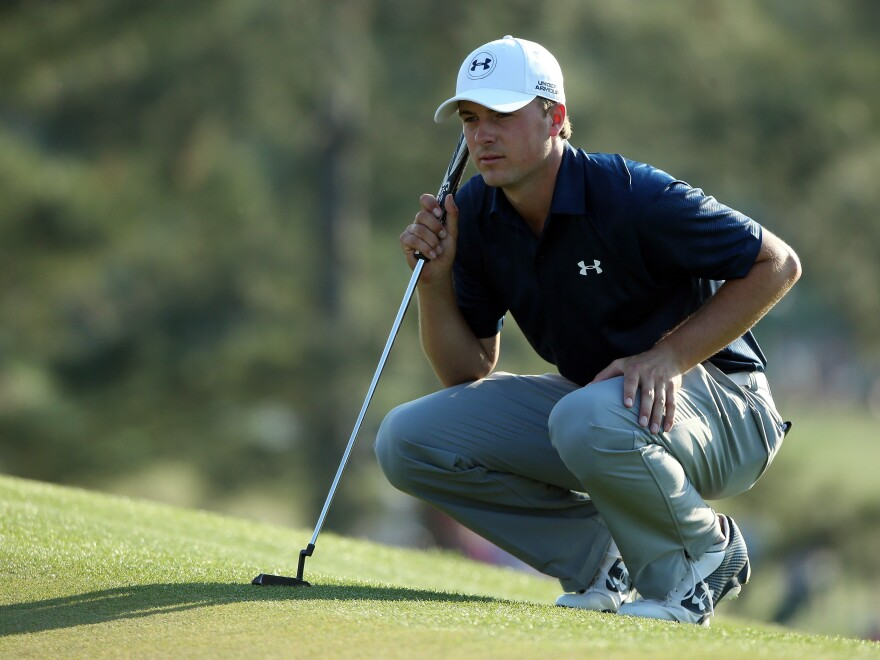 Jordan Spieth lines up a putt  during the third round of the 2014 Masters on Saturday.