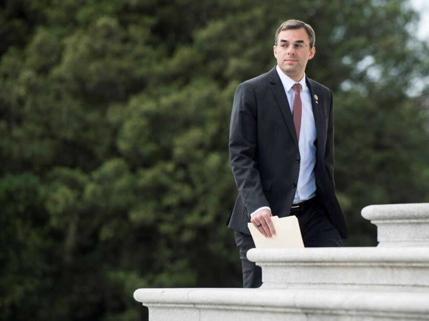 Rep. Justin Amash, R-Mich., walks up the House steps of the Capitol for the final votes before the Memorial Day recess on Thursday, May 23, 2019.