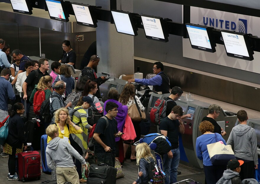 United passengers wait to check in at San Francisco International Airport on July 8. A similar computer problem disrupted flights in June as well.