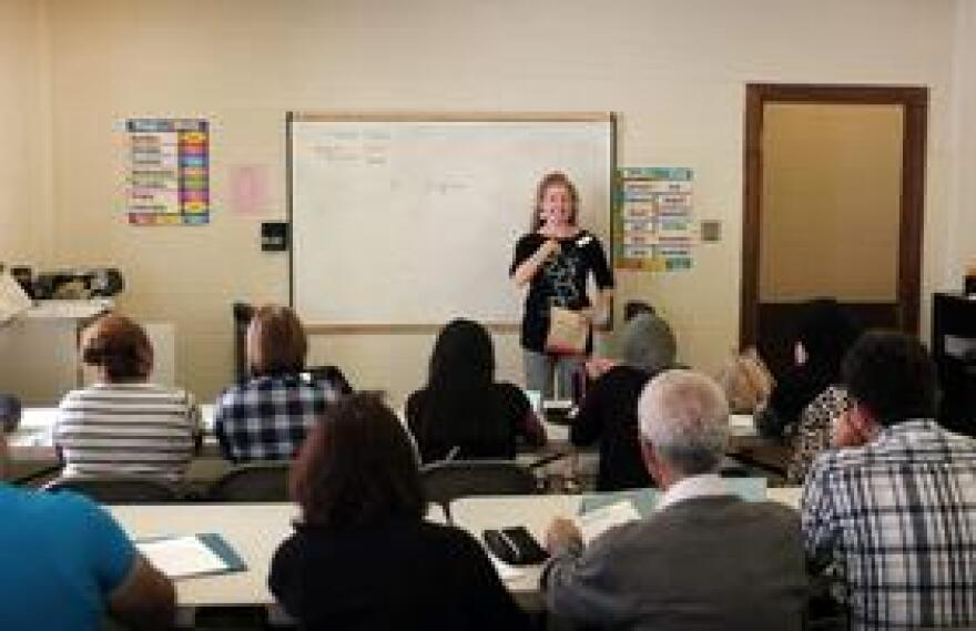 Virginia Lamp teaches English to a class of refugees in downtown Austin.