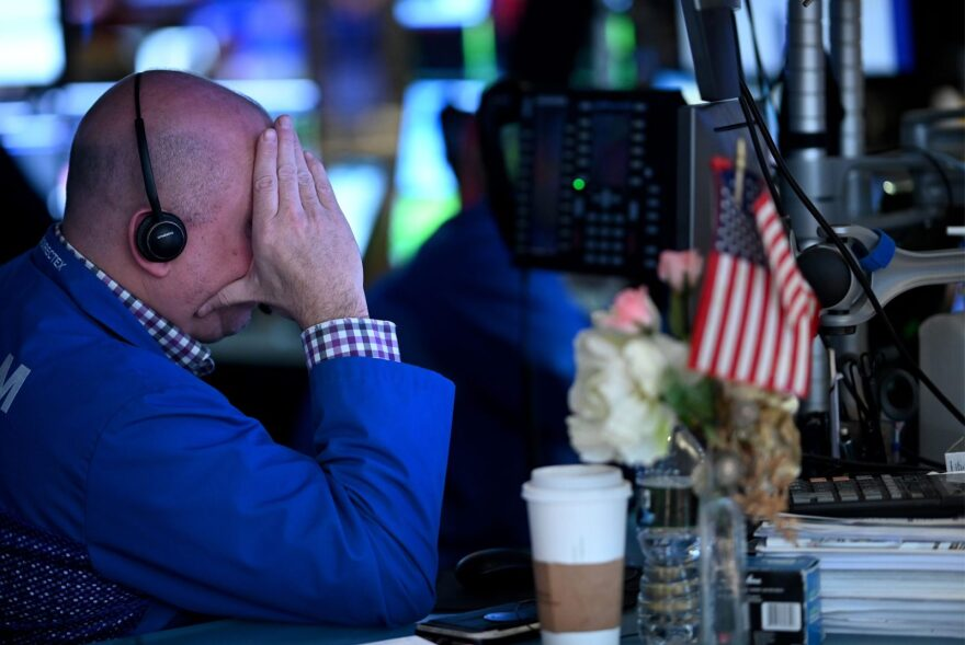 Traders work during the opening bell at the New York Stock Exchange (NYSE) at Wall Street in New York City.