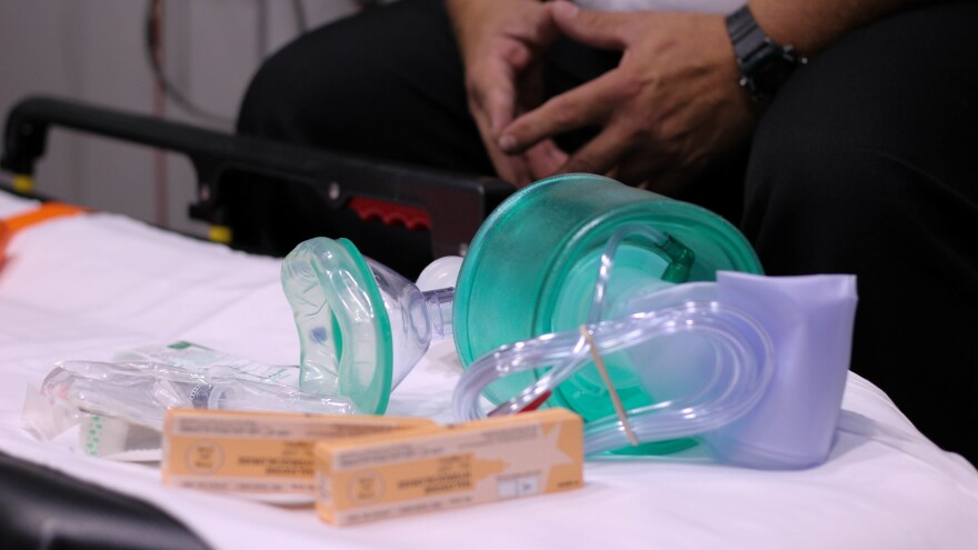 The medical supplies needed for an overdose call: a resuscitation bag, a syringe and multiple doses of Naloxone.