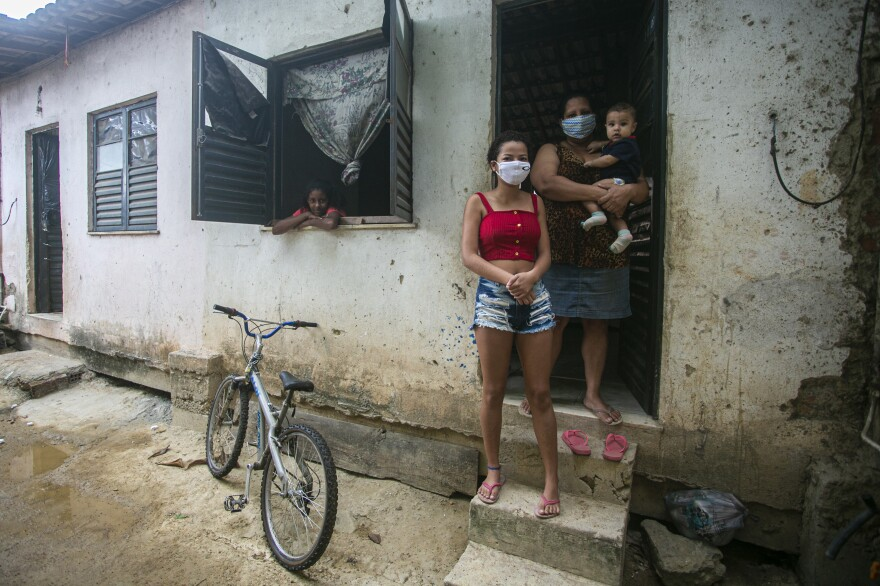 Flaviane da Conceição, 40, a self-employed house cleaner, poses for a photo at her home in the Cidade de Deus favela on July 29 in Rio de Janeiro, Brazil. A single mother of three, she applied for government emergency aid at the beginning of the coronavirus pandemic and it helps her support her family.