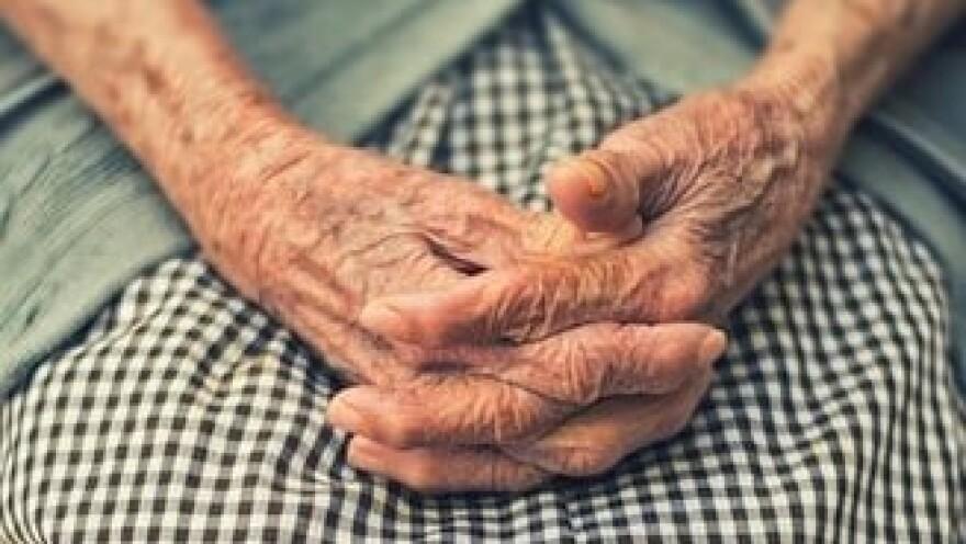 Eldery woman with hands folded