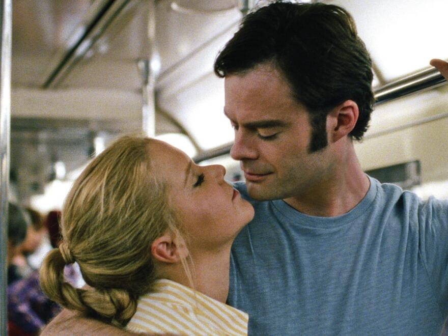 Amy (Amy Schumer) gets closer to Aaron (Bill Hader) in <em>Trainwreck</em>.