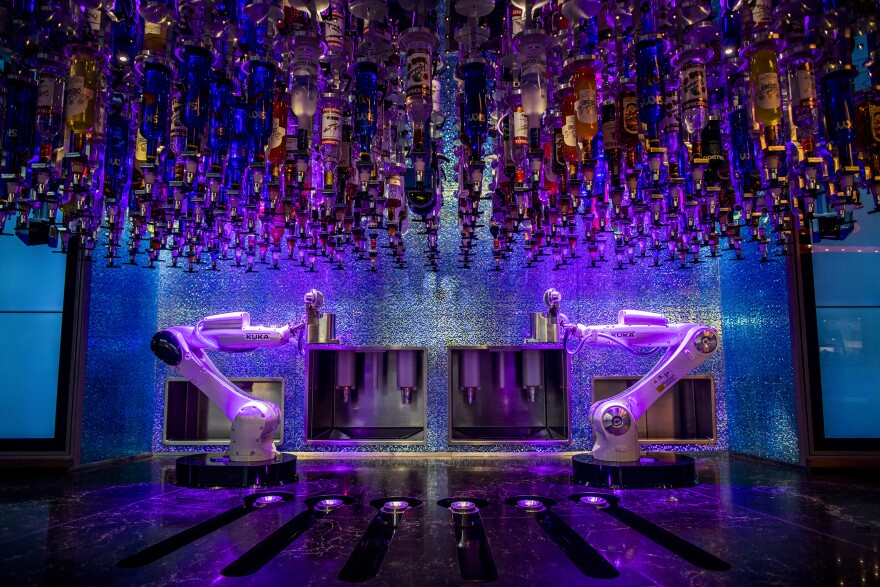 Robotic arms wait to make drinks at The Tipsy Robot in Las Vegas.