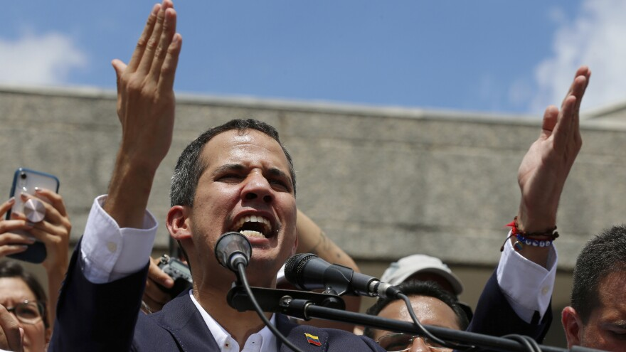 Venezuelan opposition leader Juan Guaidó speaks during a rally demanding the resignation of Venezuelan President Nicolas Maduro in Caracas on Monday.