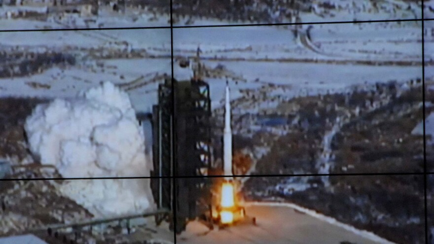 This image from North Korea's official Korean Central News Agency shows the long-range rocket Unha-3 as seen at a satellite control center prior to Wednesday's successful launch.