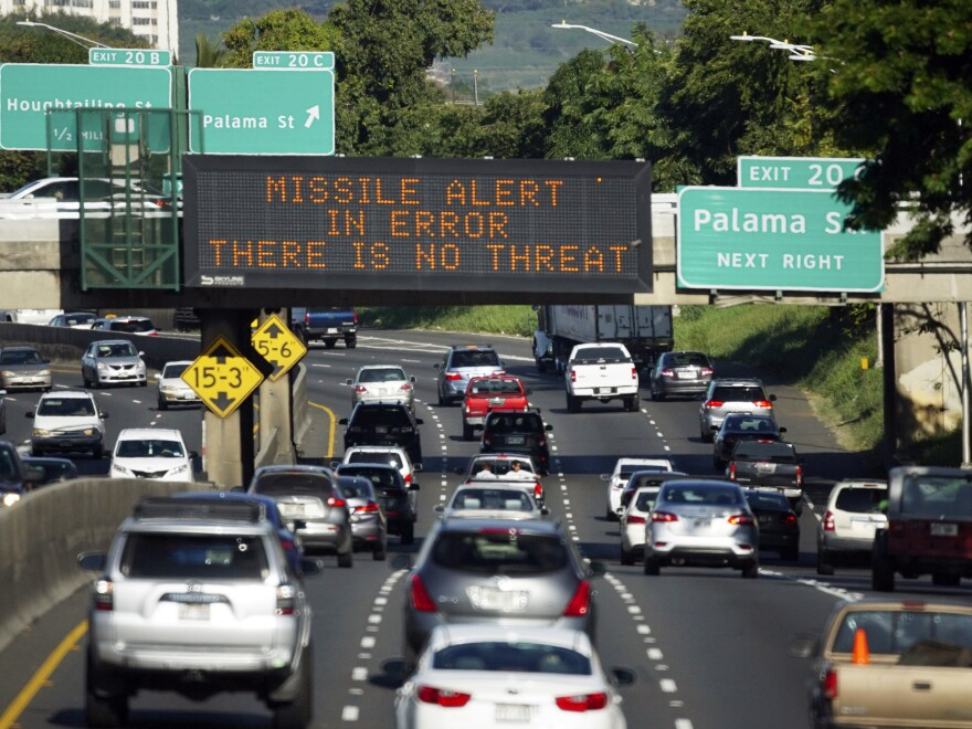 The FCC said Tuesday that the false alert of a ballistic missile sent in Hawaii on Jan. 13 occurred when the worker in charge of alerts confused a drill for a real missile emergency. A highway sign in Honolulu corrects the error.