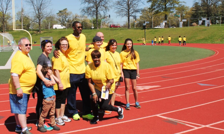 (from left) Bob, Cara and Pattie Spencer, with Larry Hughes (center rear), his mom Vanessa (front) and the family of liver transplant recipient Spencer Vincent (right) at J-Walk'N, an event promoting organ donation on April 16, 2016.