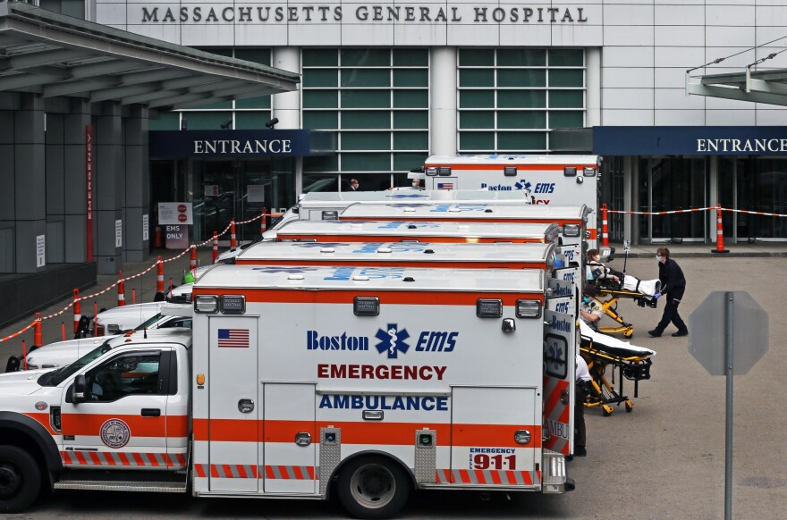 A Boston EMS ambulance crew wheels in a patient to MGH from their ambulance in Boston on April 8, 2020. Hospitals brace for a surge in patients.