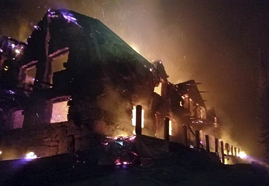 In this image taken from a video provided by the Hutton Incident Team, the historic main Sperry Chalet building in Glacier National Park is engulfed in the flames of the Sprague Fire, which is still burning.