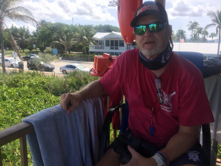 Eric Feld is the lifeguard for the lifeguards today, watching over the competition from his tower.