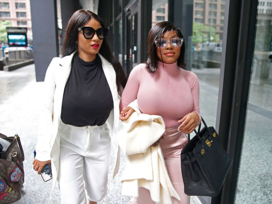 Joycelyn Savage (left) and Azriel Clary, two women who lived with R. Kelly, are seen here leaving a Chicago court room in July 2019.