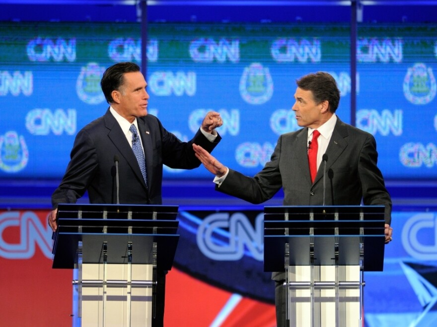 <p>Mitt Romney and Texas Gov. Rick Perry clash at Republican presidential debate, Oct. 18, 2011 in Las Vegas, Nv.</p>