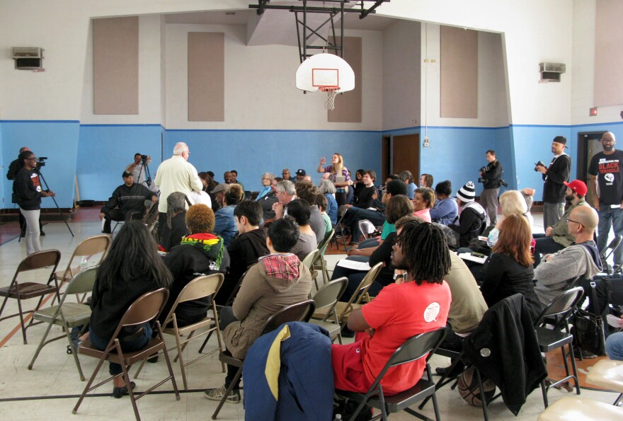 """Activists gather at a school next door to the Greater St. Mark Family Church in Ferguson, Mo., for a meeting of what the Organization for Black Struggle was calling a """"People's Movement Assembly."""""""